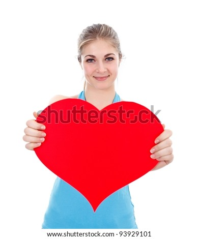 Pretty young woman with a read paper heart over white background - stock photo