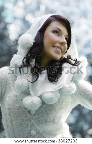 pretty young woman with a white sweater with hood in a outdoor winter portrait - stock photo
