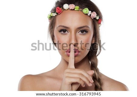 pretty young woman with a wreath of flowers and braid - stock photo