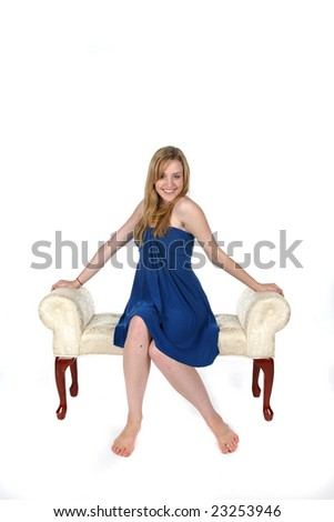 pretty young woman with bare feet sitting on bench - stock photo