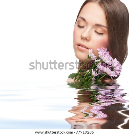 Pretty young woman with beautiful fresh make-up with flowers standing in water - stock photo