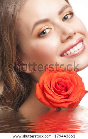 Pretty young woman with beautiful fresh makeup and perfect healthy skin with rose in water