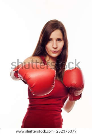 Pretty young woman with boxing gloves - stock photo