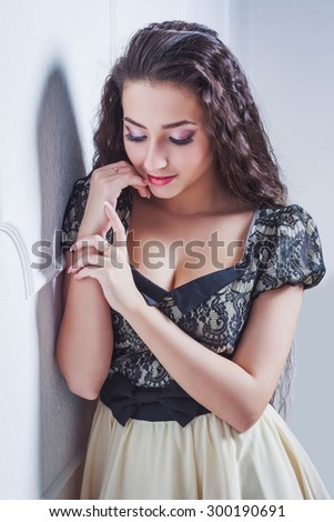 Pretty young woman with closed eyes - stock photo