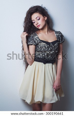 Pretty young woman with closed eyes and long hair - stock photo