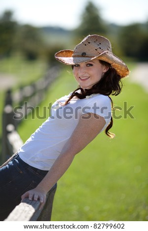 Pretty Young Woman with Cowgirl Hat Outdoor Portrait - stock photo