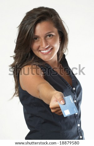 Pretty young woman with credit card for shopping, focus on hand - stock photo