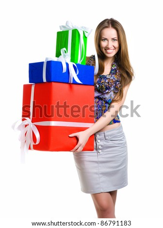 Pretty young woman with gifts on white background. Studio shot