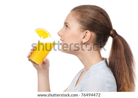 Pretty young woman with glass of orange juice isolated on the white background