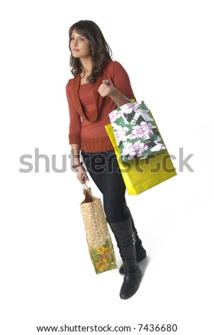 Pretty young woman with green yellow and beige shopping bags