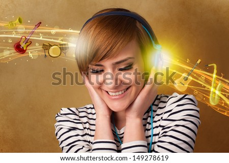 Pretty young woman with headphones listening to music, instruments concept - stock photo