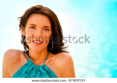 Pretty young woman with hot look and sexy smile sitting near pool
