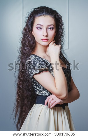 Pretty young woman with long hair - stock photo