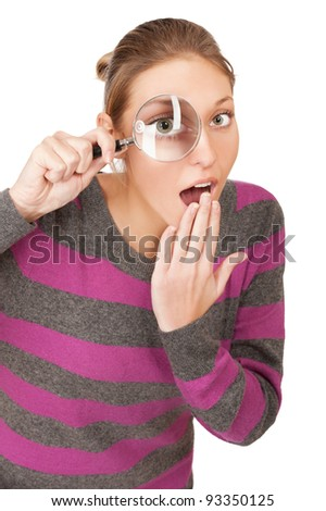 pretty young woman with magnifier isolated on the white background - stock photo