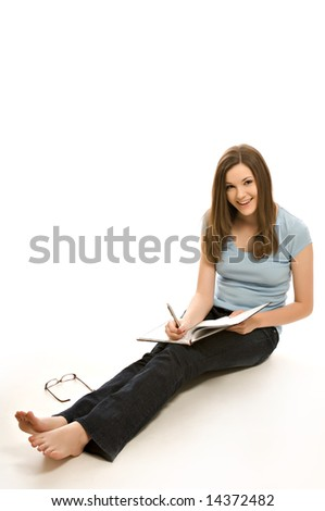 Pretty young woman with notebook - stock photo