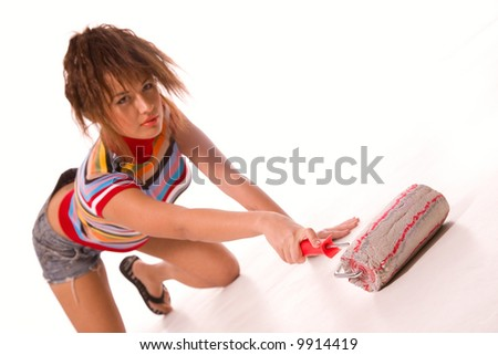 Pretty young woman with painting roller isolated on white - stock photo