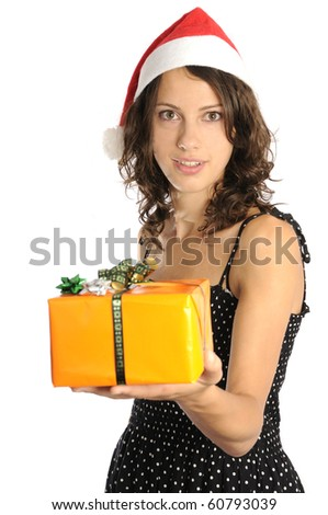 Pretty young woman with santa hat holding christmas gift - stock photo
