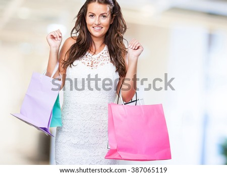pretty young woman with shopping bags