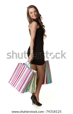 Pretty young woman with shopping bags on a white background