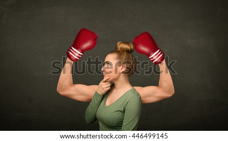 Pretty young woman with strong and muscled boxer arms concept - stock photo
