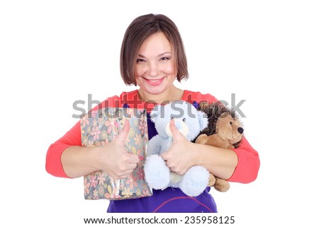 pretty young woman with the gift and soft toys