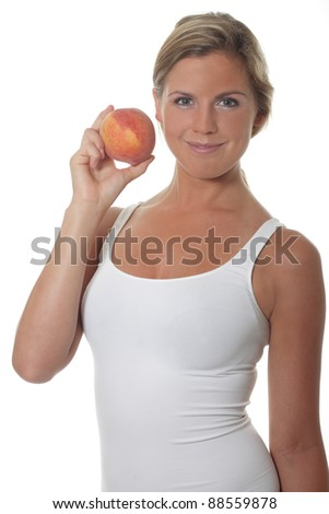 Pretty young women holds a fresh peach - stock photo