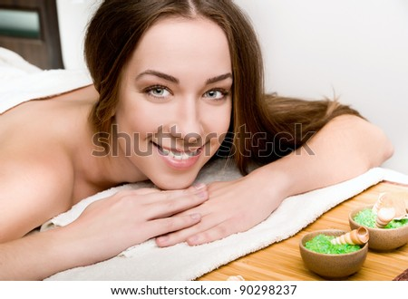 Pretty young women relaxing in the spa salon - stock photo