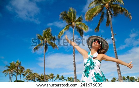 Pretty young women soaking in the sun with her arms raised on Hawaiian beach. Happiness bliss freedom concept, summer holidays travel.  - stock photo