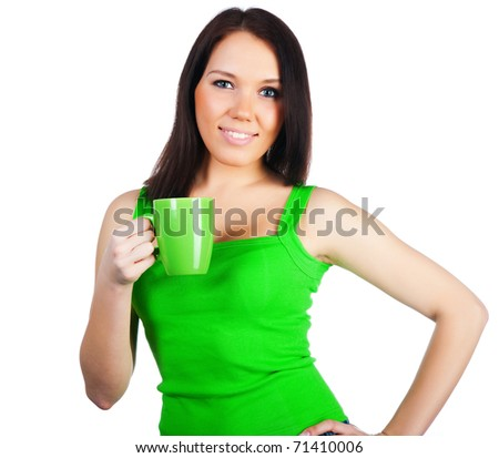 Pretty young women with the cup of tea on white - stock photo