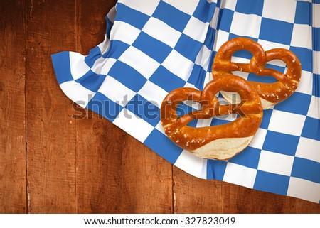 Pretzel against weathered oak floor boards background - stock photo
