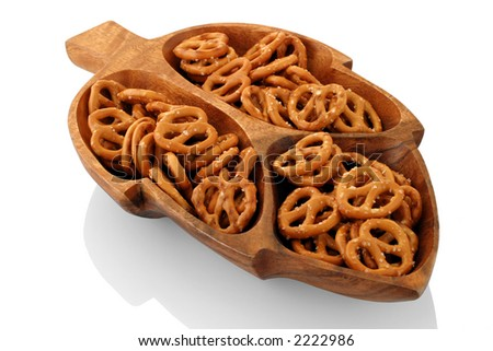Pretzels - Cocktail snack presentation in a wooden dish carved in the shape of a leaf.