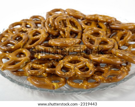 pretzels on a clear glass plate with whit background