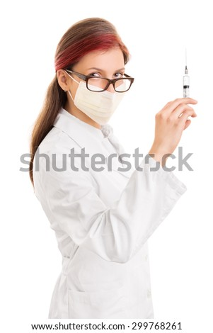 Prevention is very important. Doctor wearing surgical mask and holding syringe with needle, isolated on white background - stock photo