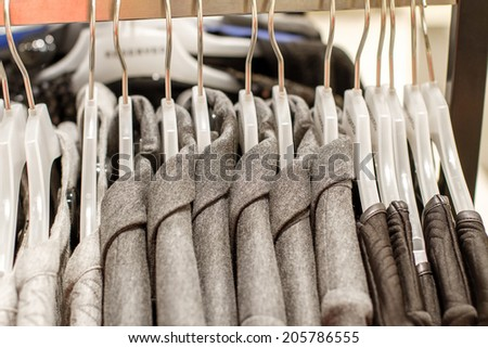 Preview jackets hanging on a hanger in the store - stock photo