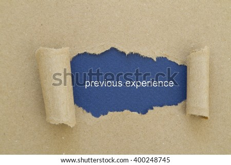 Previous experience written under torn paper. - stock photo