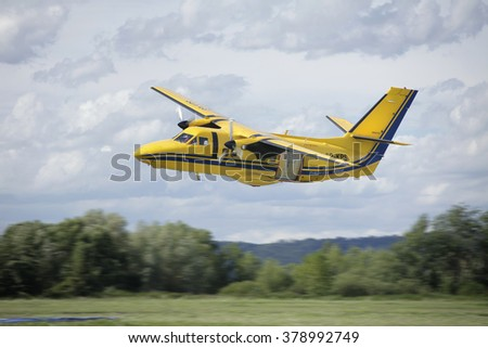 Pribram, Czech Republic -8th August 2011.  Yellow Aircraft L410 for parachuting flying over runway.