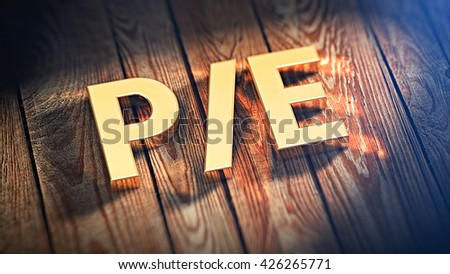 "Price/earnings ratio concept. Acronym ""P/E"" is lined with gold letters on wooden planks. 3D illustration image"