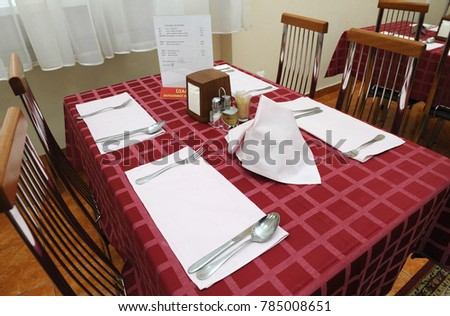 Price List Placed On A Table Setting At The Dining Room Day Of Opened Door