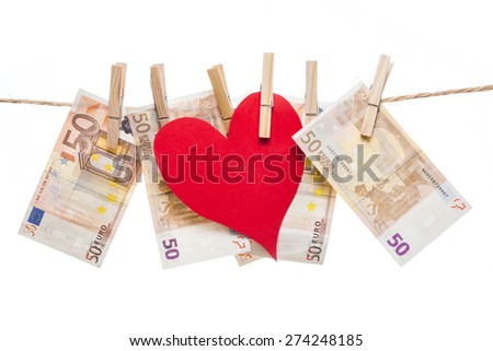 Price of love concept. Red paper heart hanging with fifty euro notes isolated on white background - stock photo