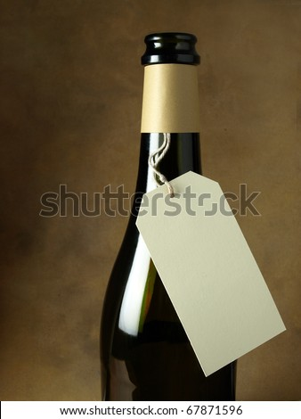 Price tag for a bottle of wine - stock photo