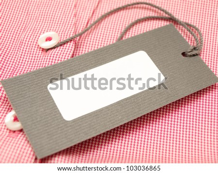 Price tag on a finest-quality shirt - close up - stock photo