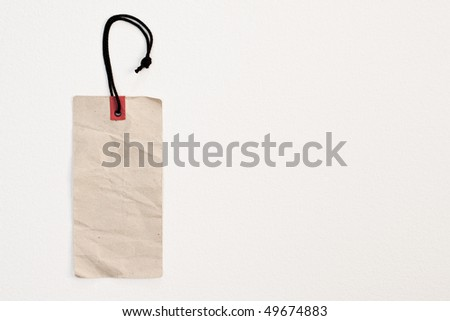 Price tag on the white painted background - stock photo