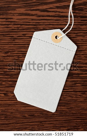 price tag on wooden background - stock photo