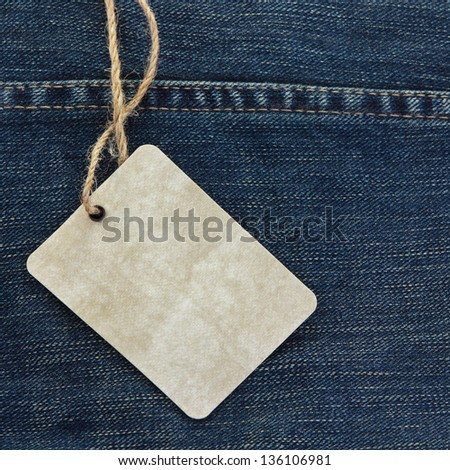Price tag over jeans background - stock photo