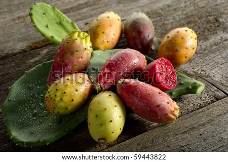 prickly pear on wood background - stock photo