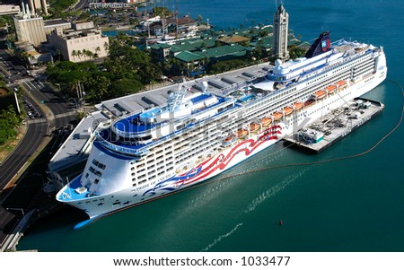 Pride Of America in Honolulu Harbor at the Aloha Tower Marketplace in Hawaii - stock photo