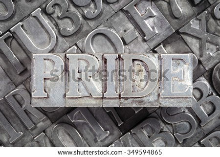 pride word concept made from metallic letterpress blocks on many letters background