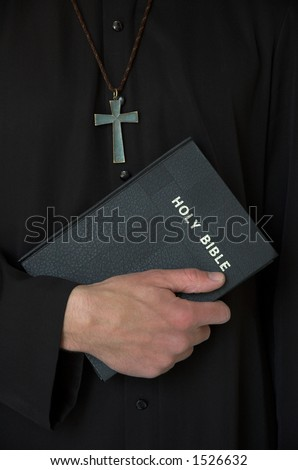 Priest holding bible with crucifix