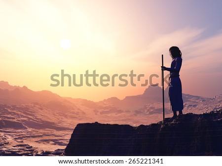 Priest piously on the mountain. - stock photo