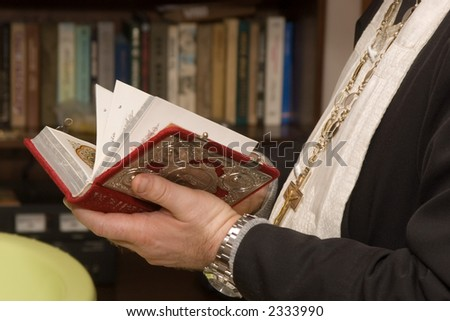 Priest with a Holy Bible - stock photo